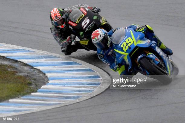 Suzuki rider Andrea Iannone of Italy leads Yamaha Tech3 rider Johann Zarco of France during the MotoGP Japanese Grand Prix at Twin Ring Motegi...