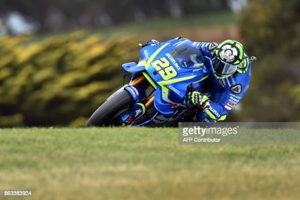 Suzuki rider Andrea Iannone of Italy powers his machine during the second practice session of the Australian MotoGP Grand Prix at Phillip Island on...