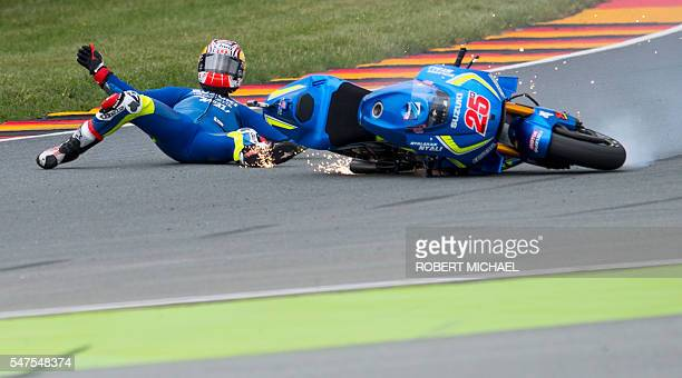 TOPSHOT Suzuki rider Maverick Vinales of Spain falls during the second training session of the Moto GP of the Grand Prix of Germany at the...