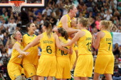 Suzy Batkovic and Lauren Jackson of Australia embrace as they celebrate with their teammates after they won 8374 against Russia during the Women's...