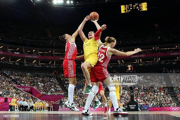 Suzy Batkovic of Australia attempts a shot in the first half against Marina Kuzina and Irina Osipova of Russia during the Women's Basketball Bronze...