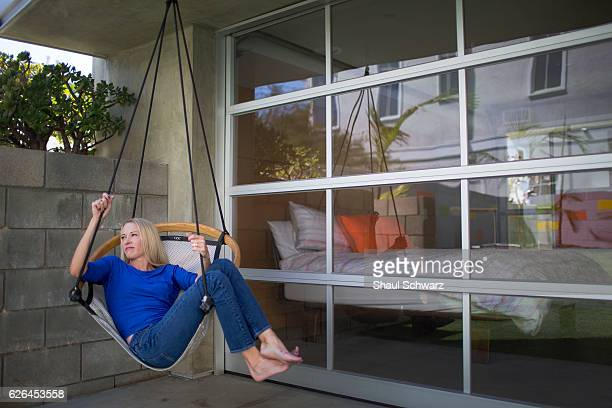 Suzy Favor Hamilton relaxes on the hammock in the backyard of her home Suzy is a threetime Olympian writer advocate wife and mother With incredible...