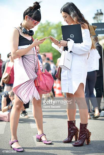 Suzy Lau and Tina Leung are seen before the Chanel show at the Grand Palais on July 7 2015 in Paris France