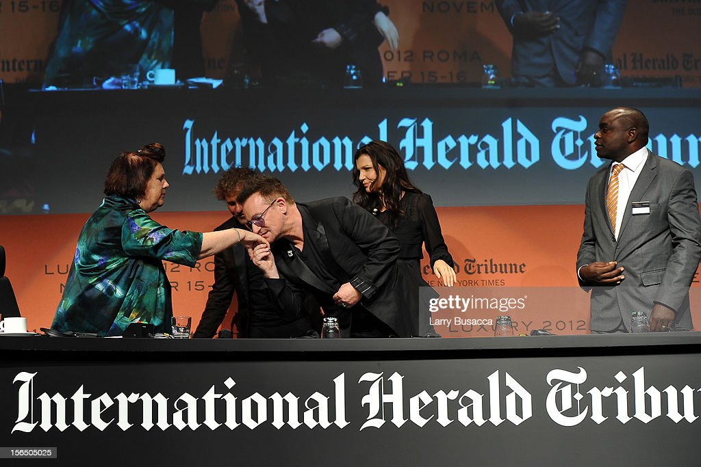 Suzy Menkes, International Herald Tribune Fashion Editor, Bono, Alison Hewson, and Erastus Kibugu of TechnoServe, leave the stage during the third day of the 2012 International Herald Tribune's Luxury Business Conference held at Rome Cavalieri on November 16, 2012 in Rome, Italy. The 12th annual IHT Luxury conference is the premier meeting point for the luxury industry. 500 delegates from 30 countries have gathered in Rome to hear from the world's most inspirational fashion designers and luxury business leaders.