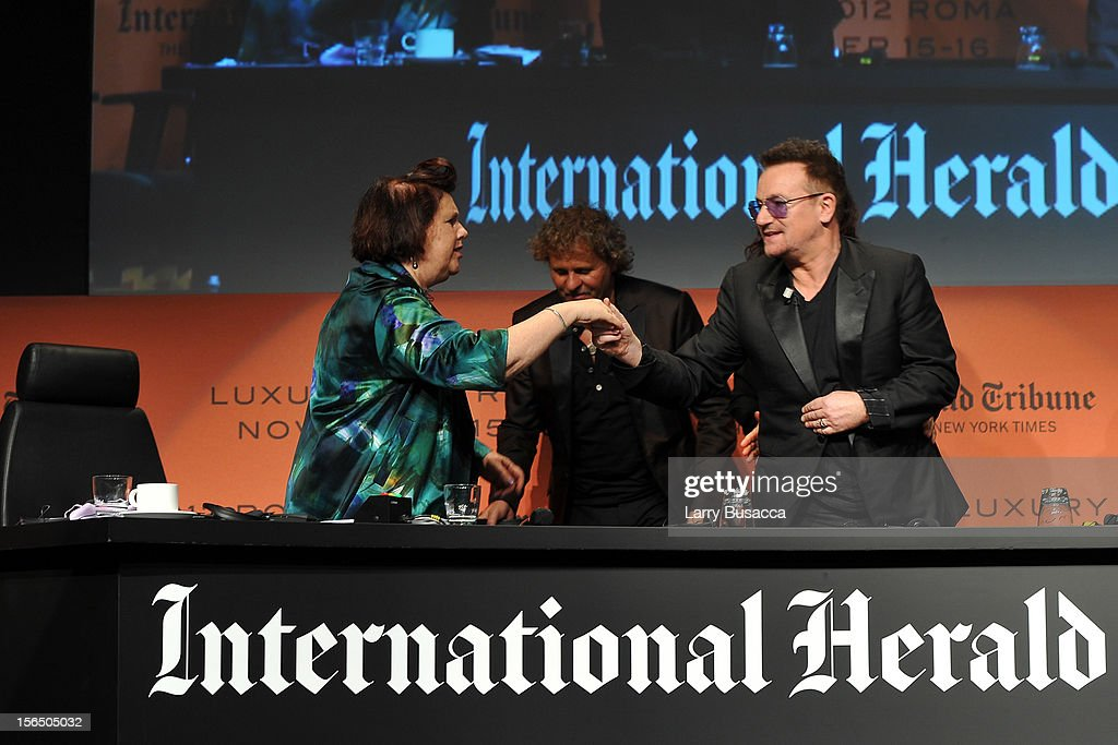Suzy Menkes, International Herald Tribune Fashion Editor, Renzo Rosso, Diesel Founder, and Bono leave the stage during the third day of the 2012 International Herald Tribune's Luxury Business Conference held at Rome Cavalieri on November 16, 2012 in Rome, Italy. The 12th annual IHT Luxury conference is the premier meeting point for the luxury industry. 500 delegates from 30 countries have gathered in Rome to hear from the world's most inspirational fashion designers and luxury business leaders.