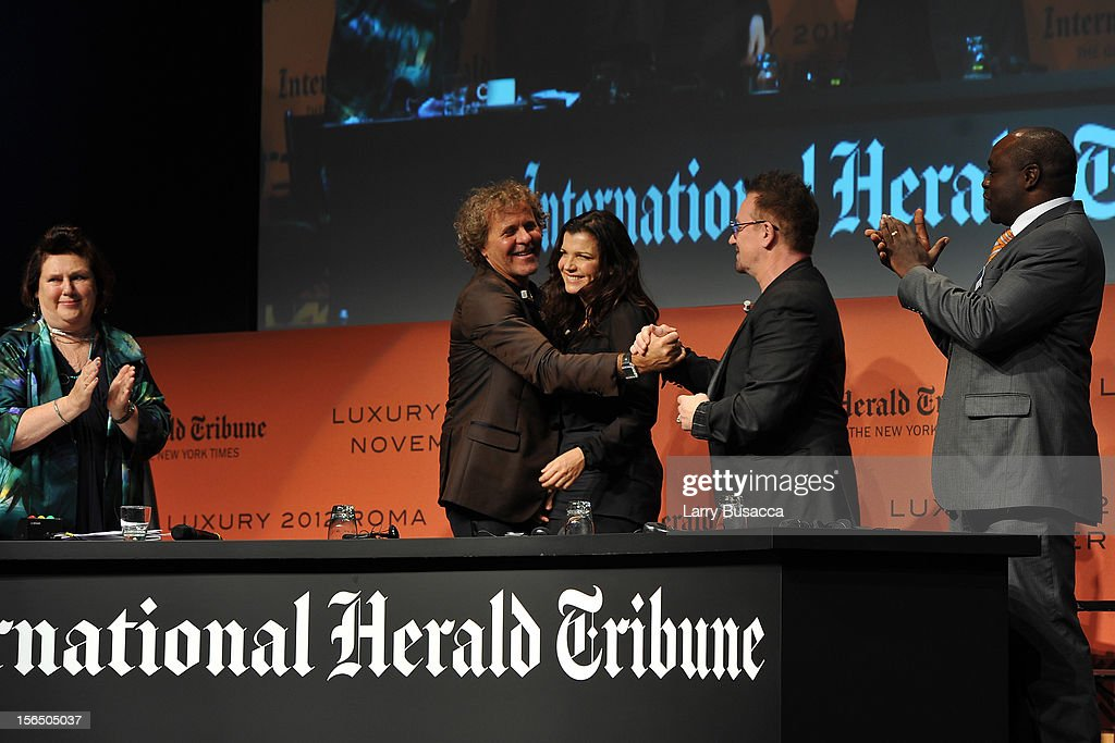 Suzy Menkes, International Herald Tribune Fashion Editor, Renzo Rosso, Diesel Founder, Alison Hewson, Bono and Erastus Kibugu of TechnoServe leave the stage during the third day of the 2012 International Herald Tribune's Luxury Business Conference held at Rome Cavalieri on November 16, 2012 in Rome, Italy. The 12th annual IHT Luxury conference is the premier meeting point for the luxury industry. 500 delegates from 30 countries have gathered in Rome to hear from the world's most inspirational fashion designers and luxury business leaders.