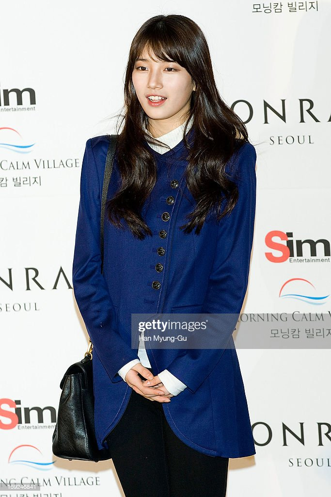 Suzy of South Korean girl group Miss A attends the wedding of Uhm Tae-Woong at Conrad Hotel on January 9, 2013 in Seoul, South Korea.