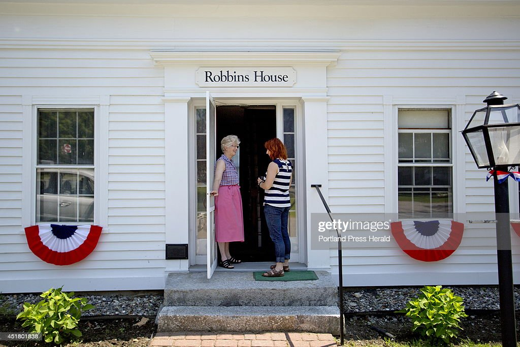 Suzy Shaub, left, curator of the Union Historical Society, talks with her intern in the doorway to the Robbins House, a historical property on the Common in Union, seen Monday, June 30, 2014.