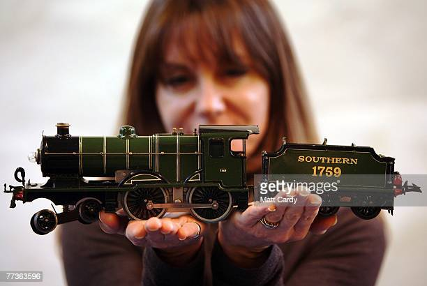 Suzy Wall from Chilcotts Auctioners and Valuers holds Lot 13 a Hornby Ogauge toy train the Folkestone Flyer valued at 10001500 GBP at The Chilcott...