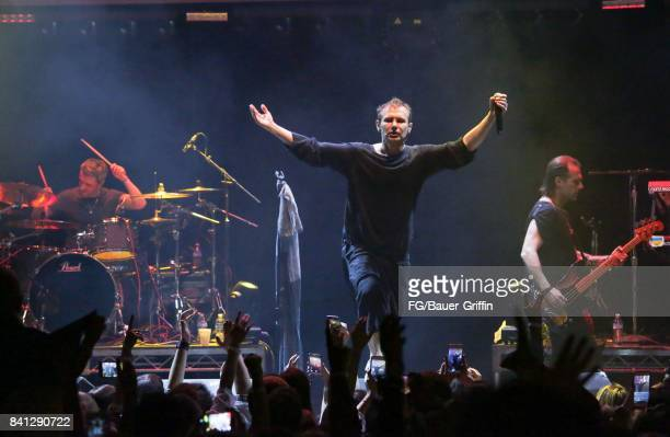 Svatoslav Vakarachuk Denis Dudko and Denis Glinin of the band Okean Enzy perform at the Avalon Hollywood on March 13 2017 in Los Angeles California