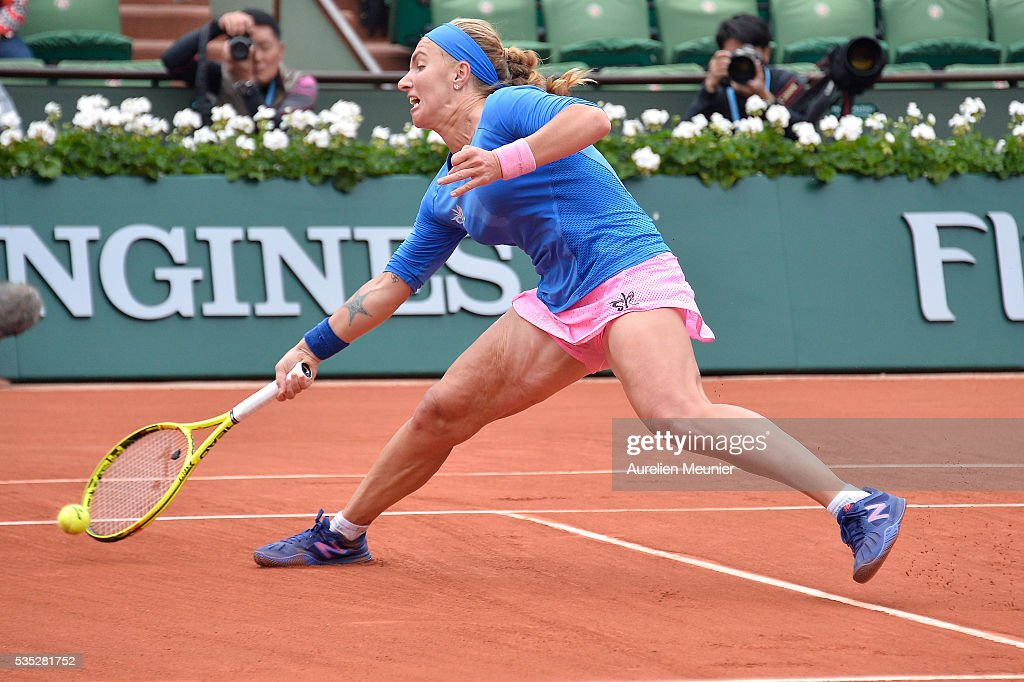 Svelatana Kuznetsova of Russia in action during her women's singles fourth round match against Garbine Muguruza of Spain on day eight of the 2016 French Open at Roland Garros on May 29, 2016 in Paris, France.