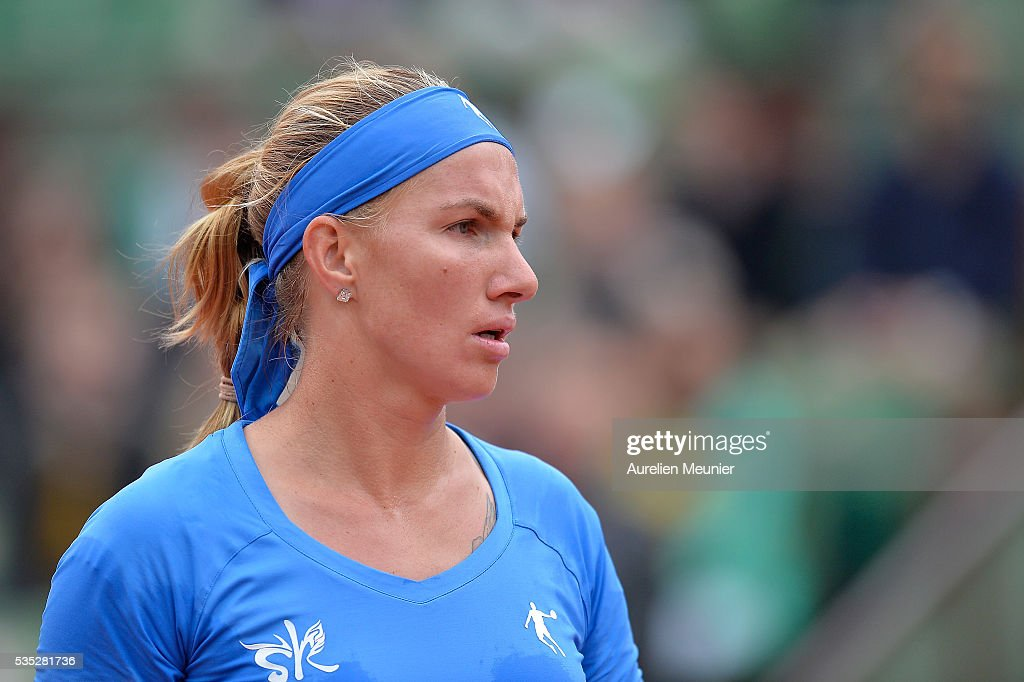 Svelatana Kuznetsova of Russia reacts during her women's singles fourth round match against Garbine Muguruza of Spain on day eight of the 2016 French Open at Roland Garros on May 29, 2016 in Paris, France.