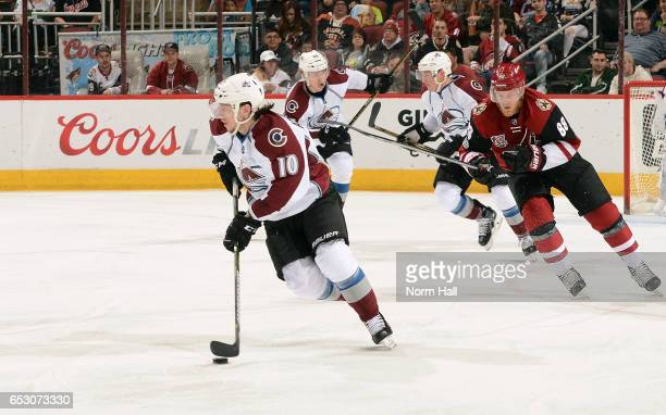 Sven Andrighetto of the Colorado Avalanche advances the puck up ice ahead of Jamie McGinn of the Arizona Coyotes during the second period at Gila...