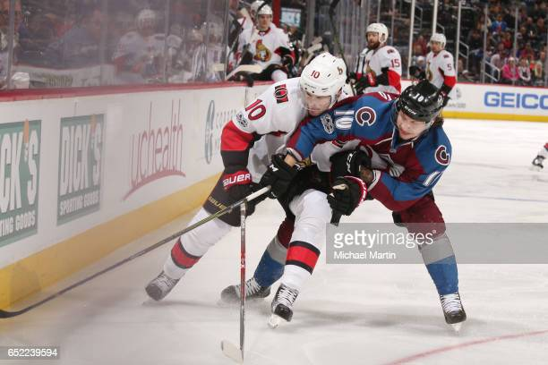 Sven Andrighetto of the Colorado Avalanche fights for position against Tom Pyatt of the Ottawa Senators at the Pepsi Center on March 11 2017 in...