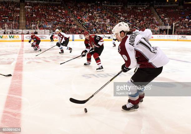 Sven Andrighetto of the Colorado Avalanche skates the puck up ice against Radim Vrbata of the Arizona Coyotes at Gila River Arena on March 13 2017 in...