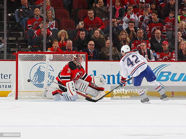 Sven Andrighetto of the Montreal Canadiens scores the game deciding goal against Cory Schneider of the New Jersey Devils in a shootout at the...