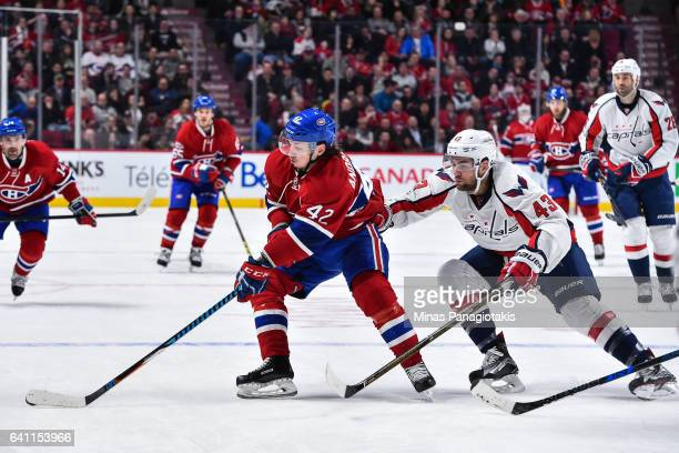 Sven Andrighetto of the Montreal Canadiens skates the puck against Tom Wilson of the Washington Capitals during the NHL game at the Bell Centre on...