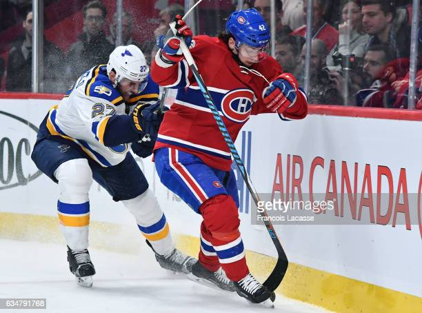 Sven Andrighetto of the Montreal Canadiens tries to keep the puck from Alex Pietrangelo of the St Louis Blues in the NHL game at the Bell Centre on...