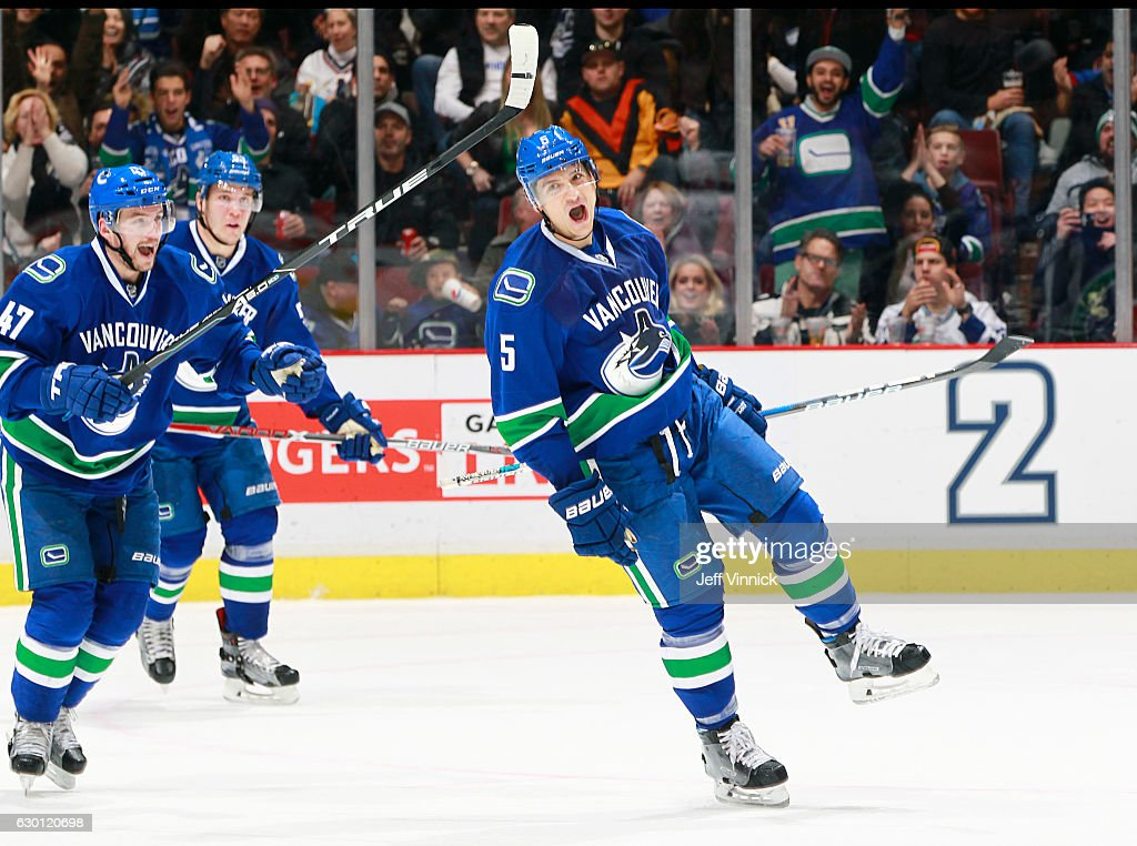 Sven Baertschi #47 and Bo Horvat #53 help Luca Sbisa #5 of the Vancouver Canucks celebrate a goal against the Tampa Bay Lightning during their NHL game at Rogers Arena December 16, 2016 in Vancouver, British Columbia, Canada.