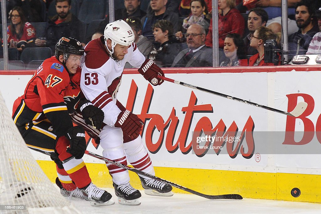 <a gi-track='captionPersonalityLinkClicked' href=/galleries/search?phrase=Sven+Baertschi&family=editorial&specificpeople=7832299 ng-click='$event.stopPropagation()'>Sven Baertschi</a> #47 of the Calgary Flames battles for the puck against <a gi-track='captionPersonalityLinkClicked' href=/galleries/search?phrase=Derek+Morris&family=editorial&specificpeople=204188 ng-click='$event.stopPropagation()'>Derek Morris</a> #53 of the Phoenix Coyotes during an NHL game at Scotiabank Saddledome on April 12, 2013 in Calgary, Alberta, Canada.
