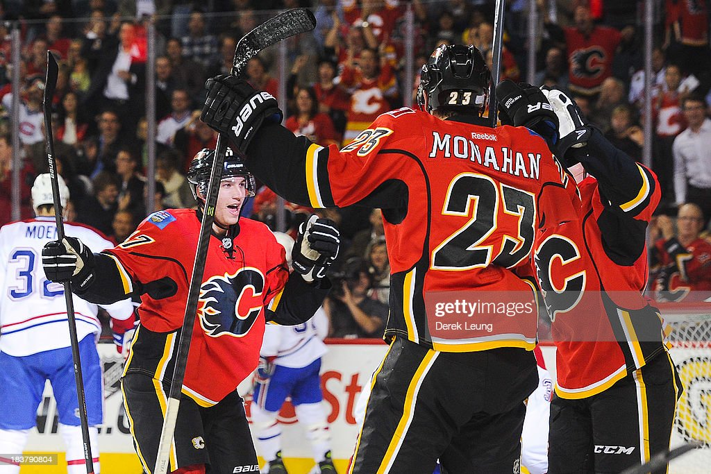 <a gi-track='captionPersonalityLinkClicked' href=/galleries/search?phrase=Sven+Baertschi&family=editorial&specificpeople=7832299 ng-click='$event.stopPropagation()'>Sven Baertschi</a> #47 of the Calgary Flames celebrates scoring the Flames' second goal against the Montreal Canadiens along with his teammate Sean Monahan #23 who assisted the goal during an NHL game at Scotiabank Saddledome on October 9, 2013 in Calgary, Alberta, Canada.