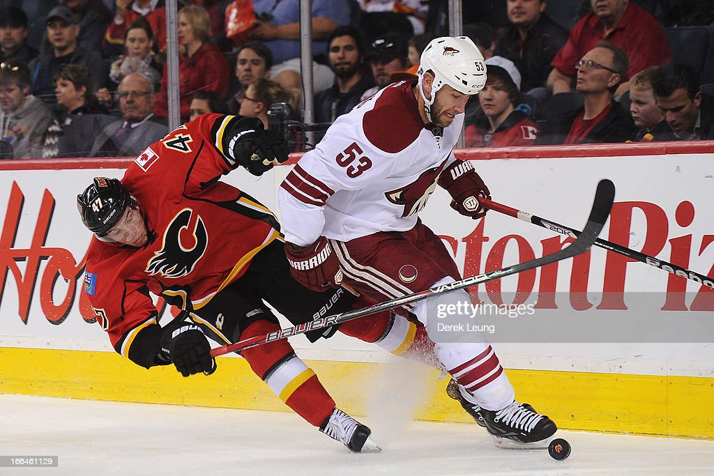 <a gi-track='captionPersonalityLinkClicked' href=/galleries/search?phrase=Sven+Baertschi&family=editorial&specificpeople=7832299 ng-click='$event.stopPropagation()'>Sven Baertschi</a> #47 of the Calgary Flames loses a skate edge as he chases <a gi-track='captionPersonalityLinkClicked' href=/galleries/search?phrase=Derek+Morris&family=editorial&specificpeople=204188 ng-click='$event.stopPropagation()'>Derek Morris</a> #53 of the Phoenix Coyotes during an NHL game at Scotiabank Saddledome on April 12, 2013 in Calgary, Alberta, Canada.