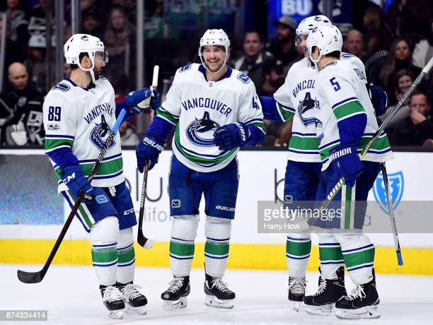 Sven Baertschi of the Vancouver Canucks celebrates his goal with Sam Gagner Derrick Pouliot and to take a 32 lead over the Los Angeles Kings during...