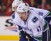 Sven Baertschi of the Vancouver Canucks in action against the Calgary Flames during an NHL game at Scotiabank Saddledome on February 19 2016 in...