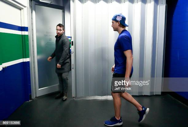 Sven Baertschi of the Vancouver Canucks looks on as teammate Sam Gagner arrives before their NHL game against the New Jersey Devils at Rogers Arena...