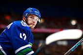 Sven Baertschi of the Vancouver Canucks looks on from the bench during their NHL game against the New York Rangers at Rogers Arena December 9 2015 in...