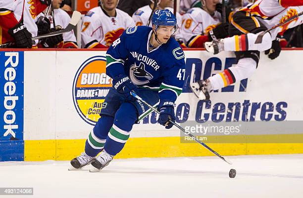 Sven Baertschi of the Vancouver Canucks skates with the puck in NHL action against the Calgary Flames on October 10 2015 at Rogers Arena in Vancouver...