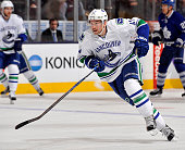 Sven Baertschi of the Vancouver Canucks turns up ice against the Toronto Maple Leafs during game action on November 14 2015 at Air Canada Centre in...