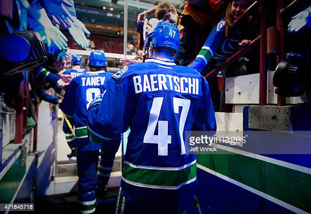 Sven Baertschi of the Vancouver Canucks walks out to the ice during their NHL game against the Arizona Coyotes at Rogers Arena April 9 2015 in...