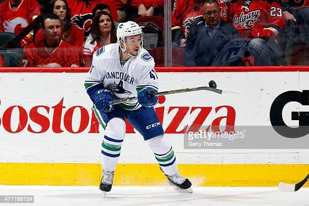 Sven Baertschi the Vancouver Canucks gains control of the puck in midair during the game against the Calgary Flames at Scotiabank Saddledome for Game...
