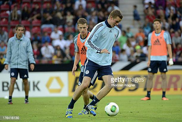 Sven Bender and his brother Lars Bender battles for the ball during the German National Football Team trainings session at Coface Arena on August 12...