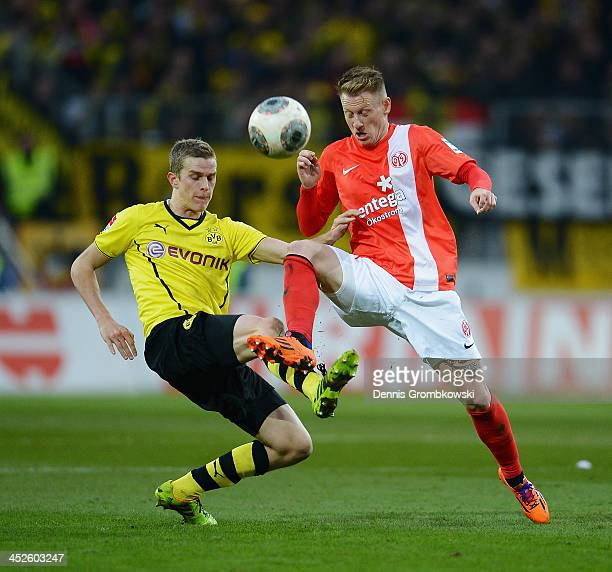 Sven Bender of Borussia Dortmund and Niki Zimling of 1 FSV Mainz 05 battle for the ball during the Bundesliga match between 1 FSV Mainz 05 and...