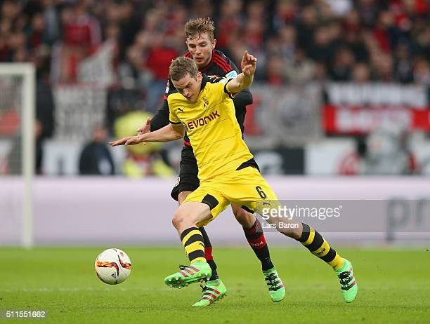 Sven Bender of Borussia Dortmund holds off Christoph Kramer of Bayer Leverkusen during the Bundesliga match between Bayer Leverkusen and Borussia...