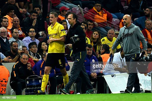 Sven Bender of Borussia Dortmund leaves the pitch due to injury during UEFA Champions League Group D match between Galatasaray and Borussia Dortmund...