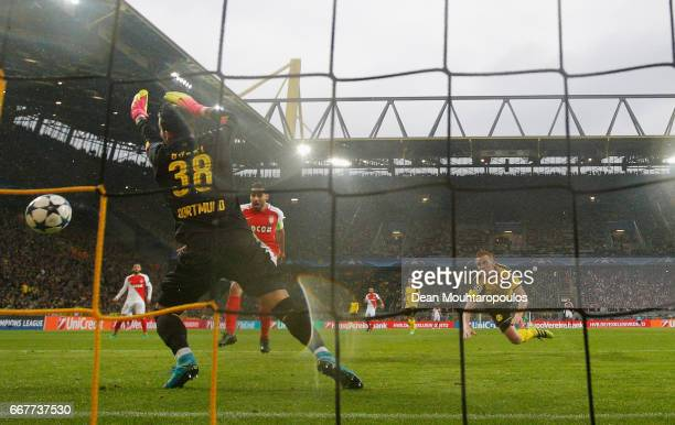 Sven Bender of Borussia Dortmund scores an own goal past Roman Buerki of Borussia Dortmund for Monaco's second goal during the UEFA Champions League...