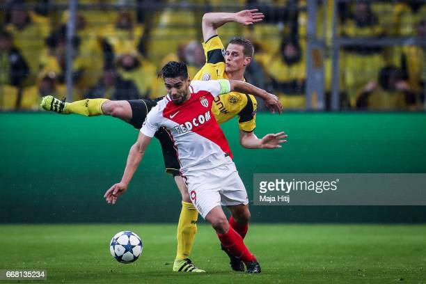 Sven Bender of Dortmund and Falcao of Monaco battle for the ball during the UEFA Champions League Quarter Final first leg match between Borussia...