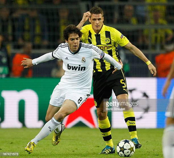 Sven Bender of Dortmund battles for the ball with Kaka of Madrid during the UEFA Champions League semi final first leg match between Borussia...
