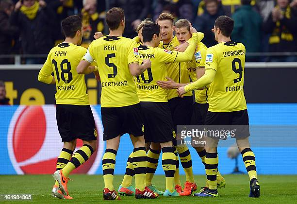 Sven Bender of Dortmund celebrates with team mates after scoring his teams first goal during the Bundesliga match between Borussia Dortmund and FC...
