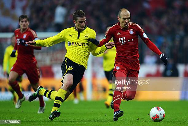 Sven Bender of Dortmund challenges Arjen Robben of Muenchen during the DFB cup quarter final match between Bayern Muenchen and Borussia Dortmund at...