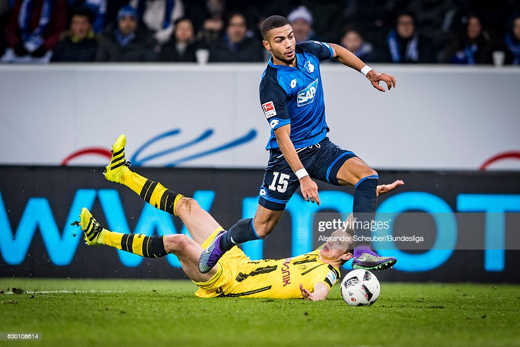 Sven Bender of Dortmund challenges Jeremy Toljan of Hoffenheim during the Bundesliga match between TSG 1899 Hoffenheim and Borussia Dortmund at Wirsol Rhein-Neckar-Arena on December 16, 2016 in Sinsheim, Germany.