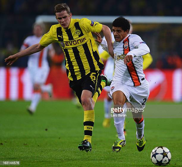 Sven Bender of Dortmund challenges Taison of Donetsk during the UEFA Champions League round of 16 second leg match between Borussia Dortmund and...
