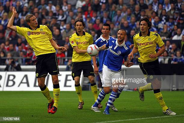 Sven Bender of Dortmund heads an offside goal during the Bundesliga match between FC Schalke 04 and Borussia Dortmund at Veltins Arena on September...
