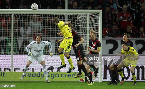 Sven Bender of Dortmund heads the ball on the cross bar during the Bundesliga match between Bayer Leverkusen and Borussia Dortmund at BayArena on...