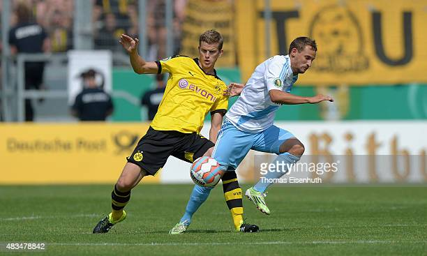 Sven Bender of Dortmund is challenged by Anton Fink of Chemnitz during the DFB Cup first round match between Chemnitzer FC and Borussia Dortmund at...