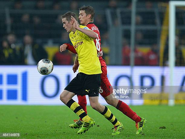 Sven Bender of Dortmund is challenged by Lars Bender of Leverkusen during the Bundesliga match between Borussia Dortmund and Bayer Leverkusen at...