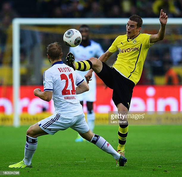 Sven Bender of Dortmund jumps for the ball next to Maximilian Beister of Hamburg during the Bundesliga match between Borussia Dortmund and Hamburger...